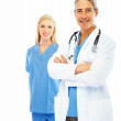 Royalty-Free Stock Photo: Happy doctor with hands folded and a female colleague at the bac