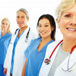 Hospital staff standing in a row over white background - Stock Photo