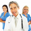 Royalty-Free Stock Photo: Happy old doctor with female colleagues at the back
