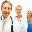 Royalty-Free Stock Photo: Hospital colleagues standing in a row over white background