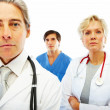 Royalty-Free Stock Photo: Group of hospital colleagues standing together on white backgrou