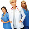 Royalty-Free Stock Photo: Confident mature doctor with female colleagues at the back