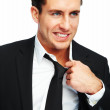 Young business man pulling his collar on white background - Stock Photo