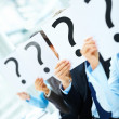 Royalty-Free Stock Photo: Colleagues holding question mark on boards in the conference roo