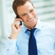 Portrait of a young confident happy businessman communicating - Stock Photo
