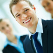 Blur image of a positive happy confident businessman smiling tow - Stock Photo