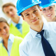 Group of successful construction workers standing together - Stockfoto
