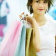 Royalty-Free Stock Photo: Closeup of a beautiful young woman holding shopping bags