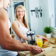 Royalty-Free Stock Photo: Happy young couple making breakfast together at home