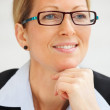 Royalty-Free Stock Photo: Portrait of a mature happy business woman wearing spectacles