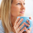 Royalty-Free Stock Photo: Closeup  of a mature woman holding a coffee cup