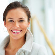 Closeup portrait of happy young female looking at copyspace - Stock Photo