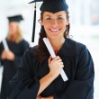 Portrait of young female graduate - Stock Photo