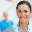 Closeup of happy young lady medical doctor - Stock Photo