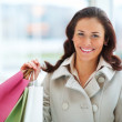 Royalty-Free Stock Photo: An attractive young lady out shopping with copyspace