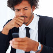 Confused young business man using his cellphone - Stock Photo