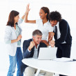 Royalty-Free Stock Photo: Team of excited business working together on a laptop