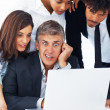 Royalty-Free Stock Photo: A shocked business team working together on a laptop