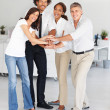 Royalty-Free Stock Photo: Team of happy business with their hands together