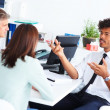 A business consultant discussing with other colleagues - Stock Photo
