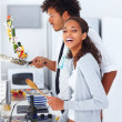 Royalty-Free Stock Photo: Happy young couple preparing food together at home