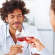 Royalty-Free Stock Photo: Happy young couple on a date having red wine and a meal together
