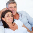 Royalty-Free Stock Photo: Happy couple relaxing together over white background