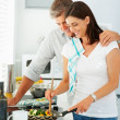 Royalty-Free Stock Photo: Happy mature couple preparing food together at home