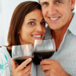 Royalty-Free Stock Photo: Closeup of a cute mature couple drinking a glass of wine togethe