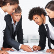 Busy business team working together during a meeting - Stock Photo