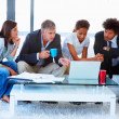 Royalty-Free Stock Photo: Business team sitting together and working on a laptop