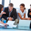Royalty-Free Stock Photo: Happy business team sitting together and working on a laptop