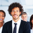 African American business man standing along with his team - Stock Photo