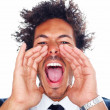 Closeup of a young man screaming out loud on a white background - Stock Photo