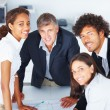 Group of happy business working together on a project - Stock Photo