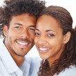 Closeup of a young beautiful attractive African couple smiling o - Стоковая фотография