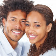 Closeup of a young beautiful attractive African couple smiling o - Stockfoto