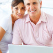Royalty-Free Stock Photo: Happy mature couple working on a laptop at home