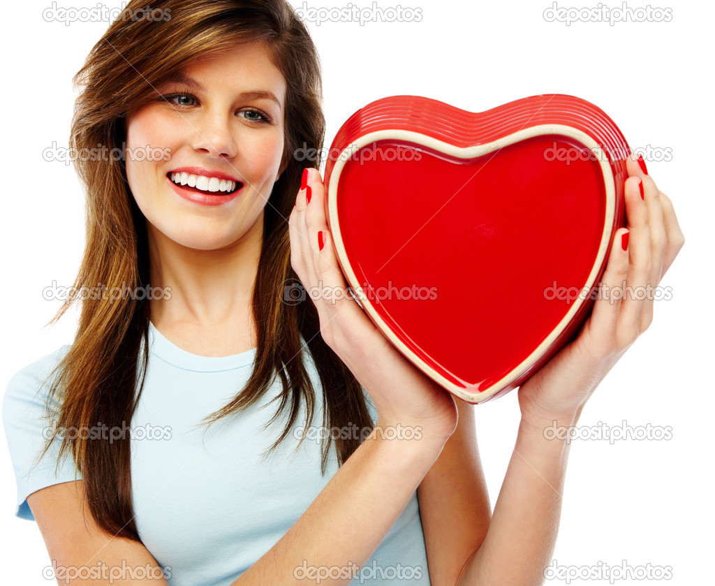 Portrait of a cute young woman holding a red heart over white background  Stock Photo #3300144