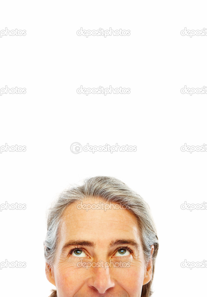 Cropped image an man 's face with his eyes looking upwards  Stock Photo #3300170