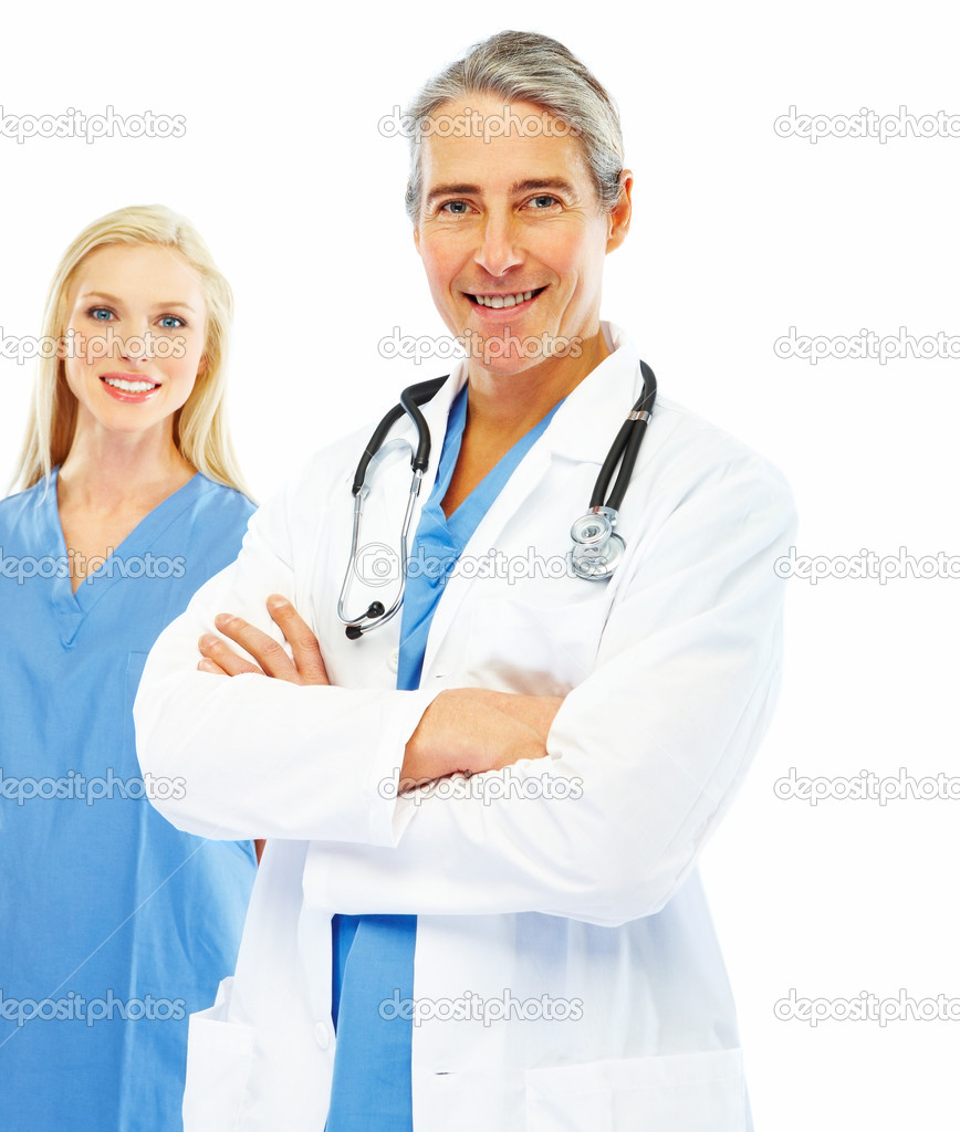Portrait of a happy doctor with hands folded and a colleague at the back on white background — Stock Photo #3300191