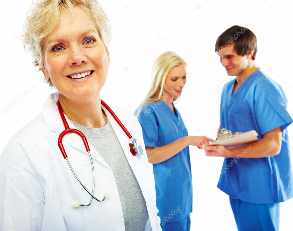 Portrait of a happy old female doctor with other colleagues at the back — Stock Photo #3300210