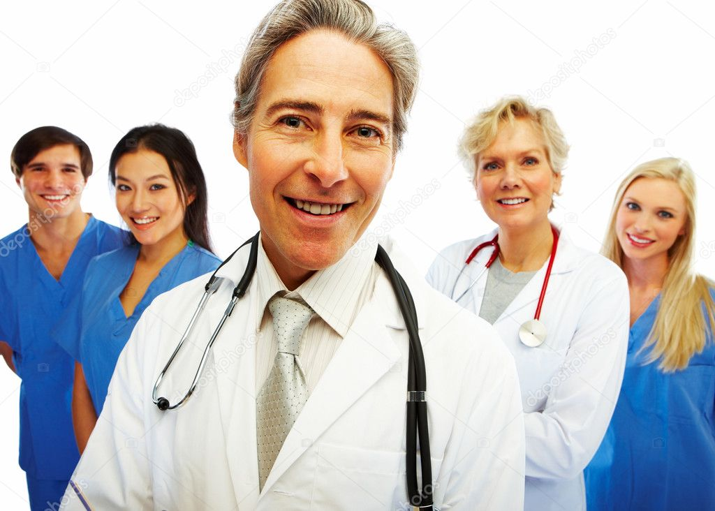 Portrait of a confident doctor with other colleagues at the back — Foto Stock #3300225