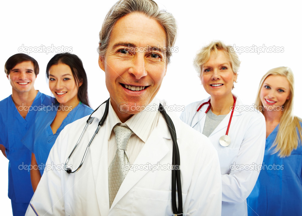 Portrait of a confident doctor with other colleagues at the back — Foto de Stock   #3300225