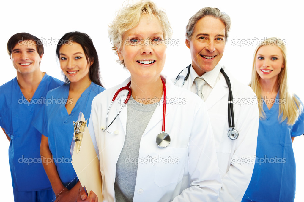 Portrait of a confident female doctor with other colleagues at the back — Stock Photo #3300226