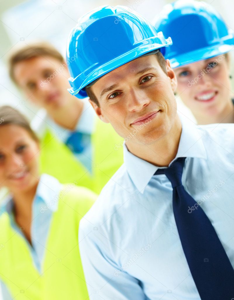 Portrait of a group of successful construction workers standing together — Stock Photo #3300465