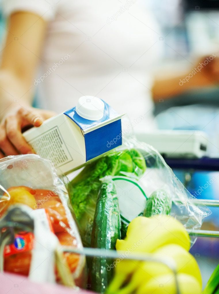 Closeup portrait of a grocery items being collected by a woman  Stock Photo #3300579