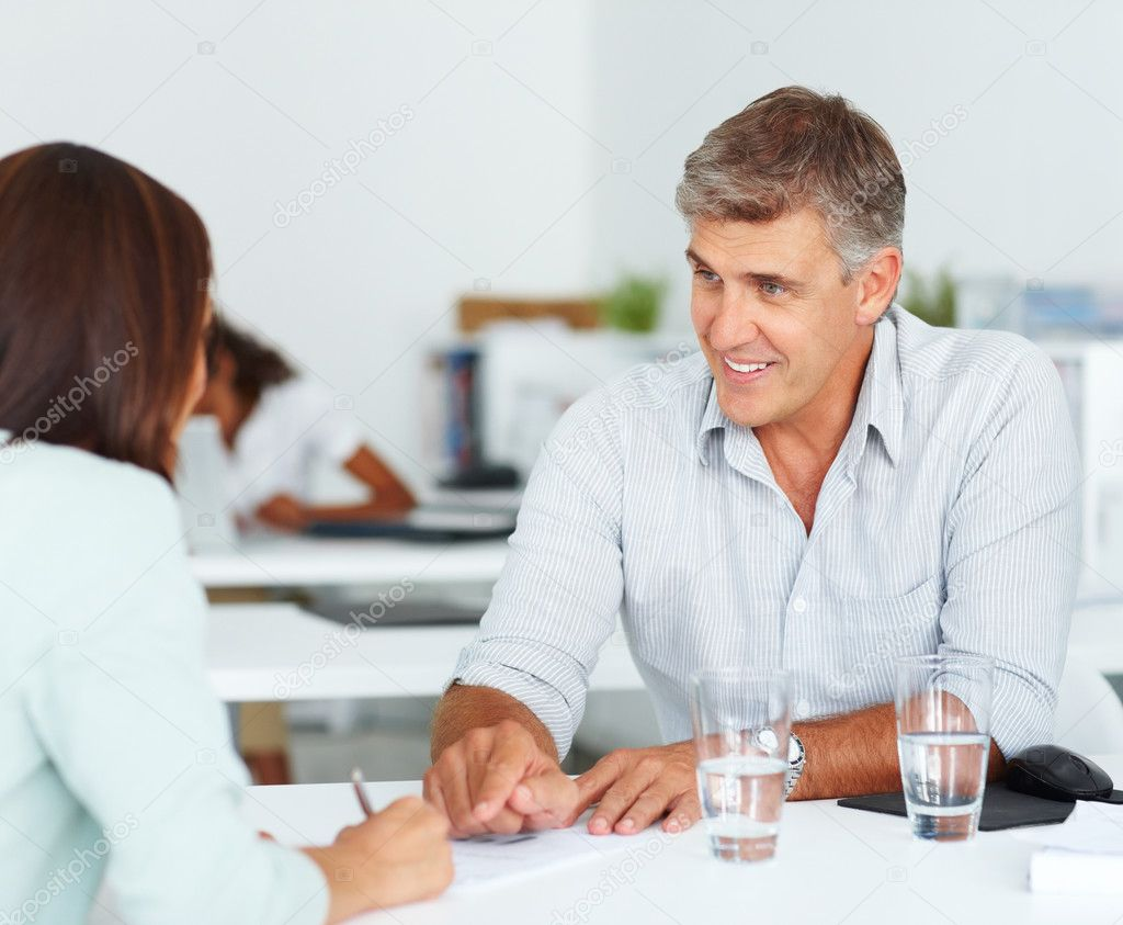Portrait of a smiling business consultant speaking with a colleague — Stock Photo #3301442