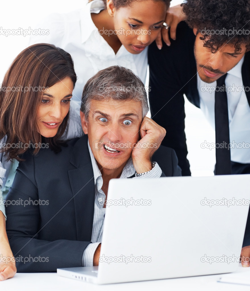 Portrait of a shocked business team working together on a laptop — Stock Photo #3301478