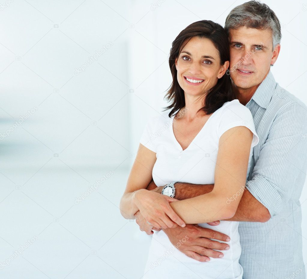 Portrait of a happy mature man with his arms around his beautiful wife — Stock Photo #3301883